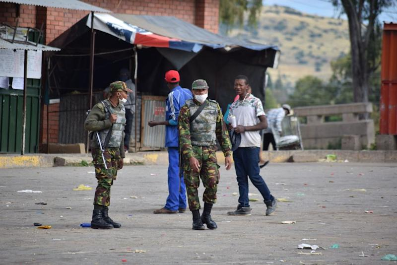 Lesotho soldiers are seen on the streets of Maseru enforcing the lockdown ordered by Prime Minister Thomas Thabane. Source: Getty
