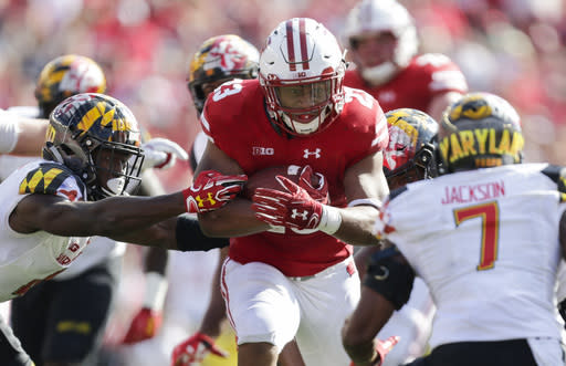 Wisconsin running back Jonathan Taylor (23) runs against Maryland defensive back Darnell Savage, left, and JC Jackson during the second half of an NCAA college football game Saturday, Oct. 21, 2017, in Madison, Wis. Wisconsin 38-14. (AP Photo/Andy Manis)