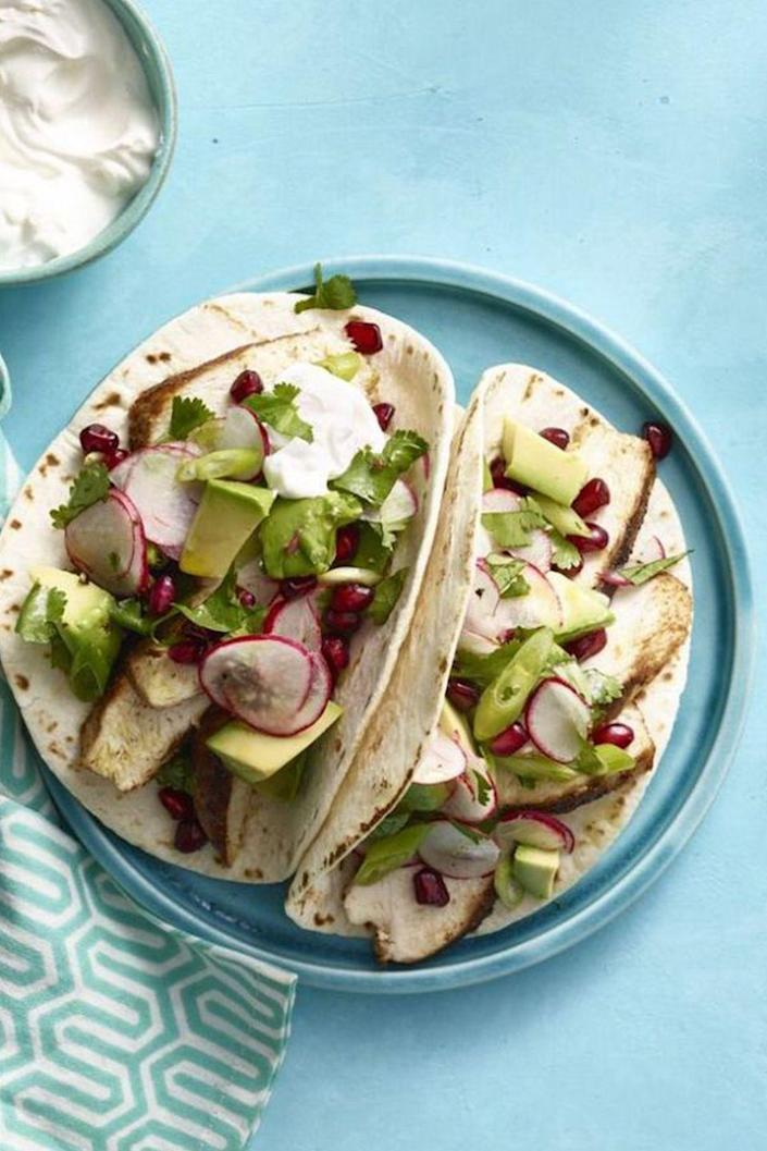 """<p>Get your daily <a href=""""https://www.womansday.com/food-recipes/food-drinks/g23/30-awesome-avocado-recipes-36194/"""" rel=""""nofollow noopener"""" target=""""_blank"""" data-ylk=""""slk:dose of avocado"""" class=""""link rapid-noclick-resp"""">dose of avocado</a> with these flour tortilla tacos, drizzled with pomegranate salsa for a sweet punch.</p><p><a href=""""https://www.womansday.com/food-recipes/food-drinks/recipes/a13250/spiced-chicken-tacos-avocado-pomegranate-salsa-recipe-wdy0315/"""" rel=""""nofollow noopener"""" target=""""_blank"""" data-ylk=""""slk:Get the recipe for Spiced Chicken Tacos."""" class=""""link rapid-noclick-resp""""><u><em>Get the recipe for Spiced Chicken Tacos.</em></u></a></p>"""