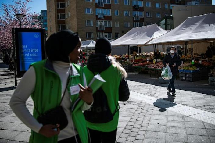 The 'youth ambassadors carry flyers with information about the disease and take up positions on streets and squares to approach pedestrians (AFP Photo/Jonathan NACKSTRAND)