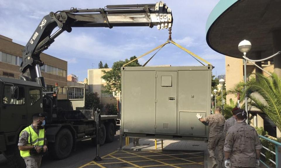 In this photo provided by the Spanish Ministry of Defence, soldiers install modules in the car park of the Hospital Clínico Universitario in Zaragoza, Spain, on Tuesday.