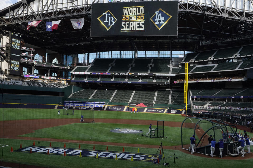 Members on the Los Angeles Dodgers take warms up during batting practice before Game 1 of the baseball World Series Series against the Tampa Bay Rays Tuesday, Oct. 20, 2020, in Arlington, Texas. (AP Photo/Sue Ogrocki)