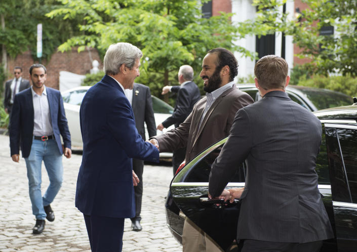 John Kerry, then U.S. secretary of state, left, greets Saudi Deputy Crown Prince Mohammed bin Salman outside Kerry's Washington, D.C., residence, before a meeting with him in June 2016.