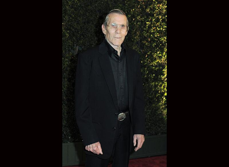 "FILE - In this Dec. 1, 2012 file photo, Hal Needham arrives at the 4th Annual Governors Awards at Hollywood and Highland Center's Ray Dolby Ballroom in Los Angeles. Needham, a top Hollywood stuntman who turned to directing rousing action films including ""Smokey and the Bandit"" and ""The Cannonball Run,"" died Friday, Oct. 25, 2013, his business managers told the Los Angeles Times. He was 82. (Photo by Jordan Strauss/Invision/AP, File)"