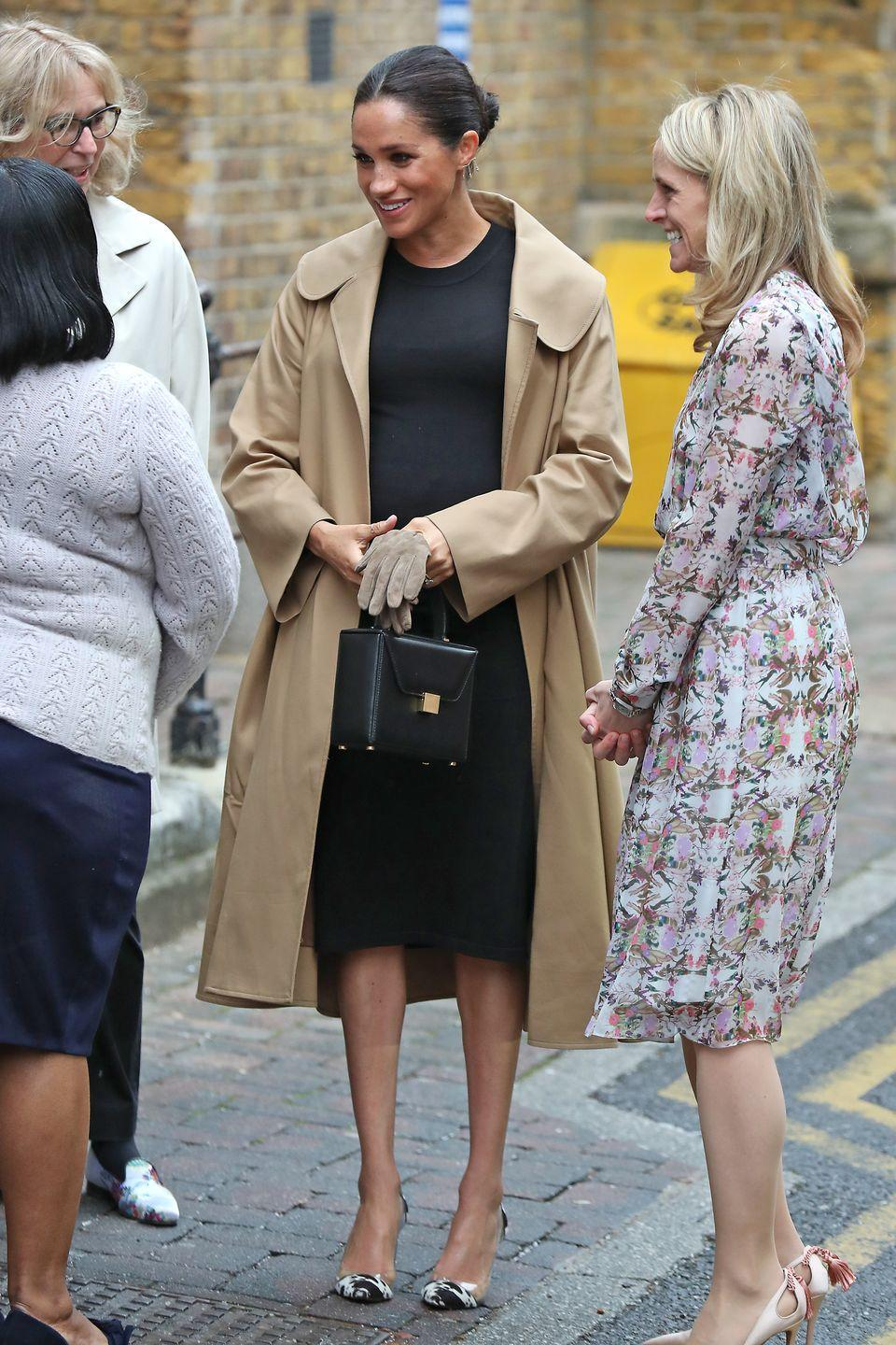 "<p>The Duchess of Sussex wore an Oscar de la Renta coat over a black dress by Hatch for a visit to Smart Works, one of <a href=""https://www.townandcountrymag.com/society/tradition/a25834957/meghan-markle-hatch-maternity-dress-smart-works/"" rel=""nofollow noopener"" target=""_blank"" data-ylk=""slk:her newly announced Royal patronages"" class=""link rapid-noclick-resp"">her newly announced Royal patronages</a>. The Duchess paired the look with Kimai earrings and printed pumps. </p><p><a class=""link rapid-noclick-resp"" href=""https://go.redirectingat.com?id=74968X1596630&url=https%3A%2F%2Fwww.hatchcollection.com%2Fcollections%2Fdresses%2Fproducts%2Fthe-eliza-dress&sref=https%3A%2F%2Fwww.townandcountrymag.com%2Fstyle%2Ffashion-trends%2Fg3272%2Fmeghan-markle-preppy-style%2F"" rel=""nofollow noopener"" target=""_blank"" data-ylk=""slk:SHOP NOW"">SHOP NOW</a><em>The Eliza Dress by Hatch, $218 </em></p>"