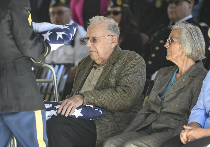 Douglas Smead ,left, and his sister Harriet Eggleston receive American flags as their brother Korean War veteran Army Cpl. Walter Smead, a member of Battery A, 57th Field Artillery Battalion, 7th Infantry Division who was killed during the 1950 Battle of the Chosin Reservoir, is laid to rest with full military honors at Gerald B. H. Solomon Saratoga National Cemetery, on Monday, Sept. 20, 2021, in Schuylerville, N.Y. Korean War veteran Army Cpl. Walter Smead, a member of Battery A, 57th Field Artillery Battalion, 7th Infantry Division who was killed during the 1950 Battle of the Chosin Reservoir, is laid to rest with full military honors at Gerald B. H. Solomon Saratoga National Cemetery, on Monday, Sept. 20, 2021, in Schuylerville, N.Y. Smead was finally laid to rest near his rural upstate New York hometown, seven decades after he was killed in the Korean War and months after his remains were finally identified with help from DNA analysis. (AP Photo/Hans Pennink)