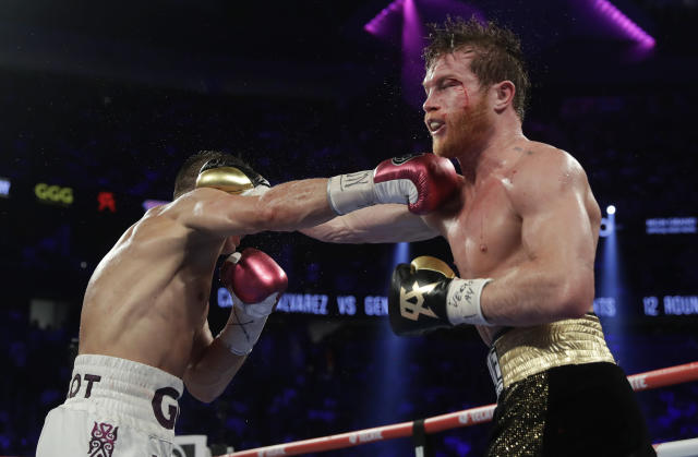 Canelo Alvarez, right, and Gennady Golovkin trade punches in the ninth round during a middleweight title boxing match, Saturday, Sept. 15, 2018, in Las Vegas. (AP Photo/Isaac Brekken)
