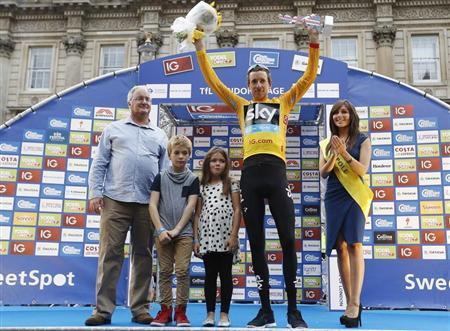 Britain's Wiggins, with his children, celebrate being overall winner of the Tour of Britain and receiving the gold jersey in Whitehall, central London