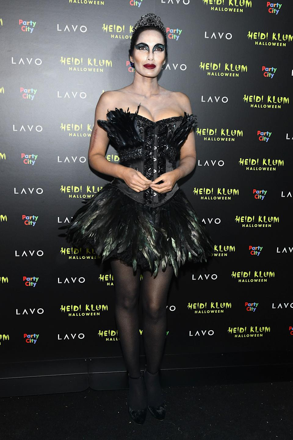 While Padma Lakshmi's <em>Black Swan</em> costume is fairly elaborate, you can cop a simpler version for yourself at the last minute if you have black tights, a black leotard, and a makeup bag's worth of black eyeshadow.