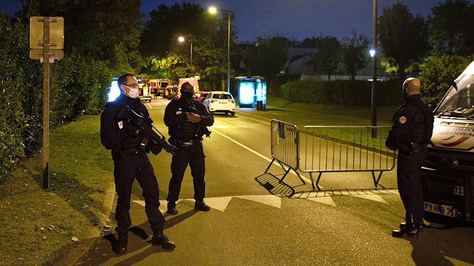 French police officers guard a street in Eragny on Friday where an attacker was shot dead by policemen after he decapitated a man. Source: AFP/Getty