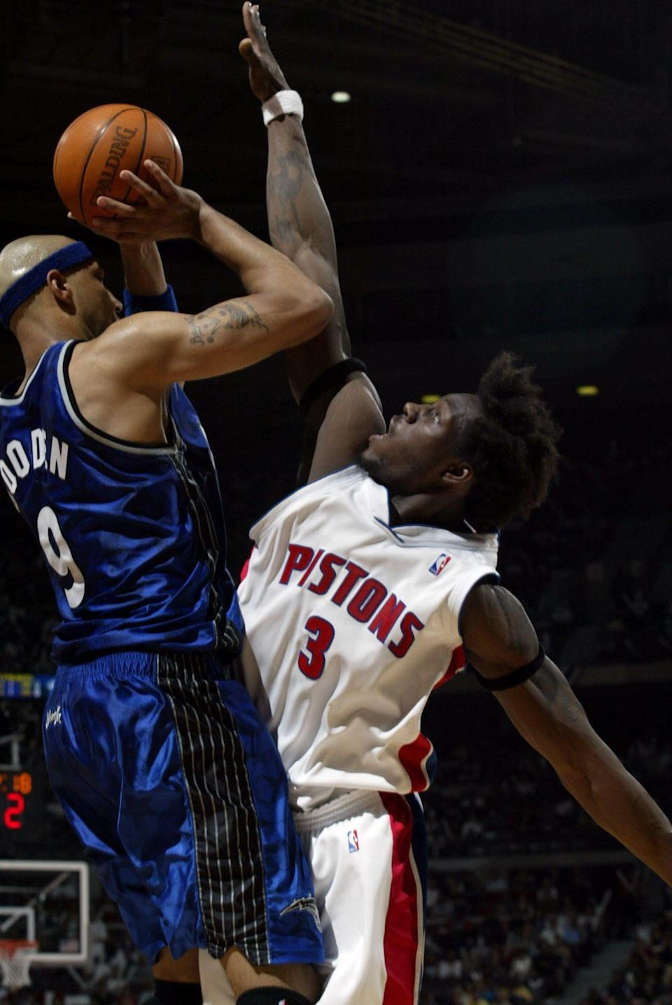 Ben Wallace forces a miss by Orlando's Drew Gooden at the Palace, April 20, 2003 in the playoffs.
