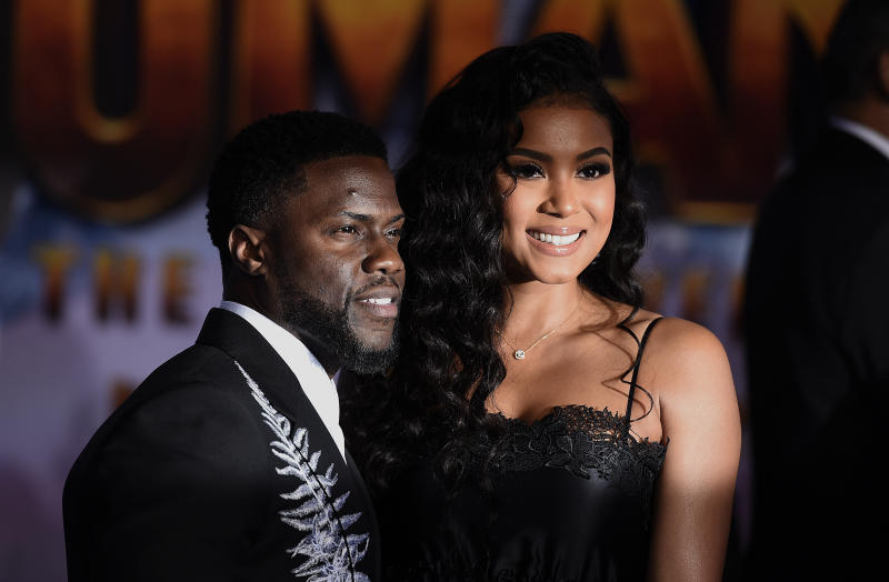 "Cast member Kevin Hart, left, and his wife, Eniko Parrish, arrive at the Los Angeles premiere of ""Jumanji: The Next Level"" at the TCL Chinese Theatre on Monday, Dec. 9, 2019. (Photo by Jordan Strauss/Invision/AP)"