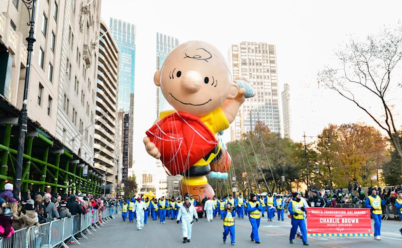 Hundreds of balloon handlers are assigned to hold the iconic characters in the Macy's Thanksgiving Day Parade. (Photo by James Devaney/WireImage,)