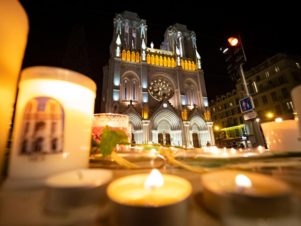 NICE, FRANCE - OCTOBER 29:  People pay tribute at night in front of Notre Dame Basilica on October 29, 2020 in Nice, France. A man armed with a knife fatally attacked people in the church, located in the heart of the city. (Photo by Arnold Jerocki/Getty Images) (Photo: Arnold Jerocki via Getty Images)