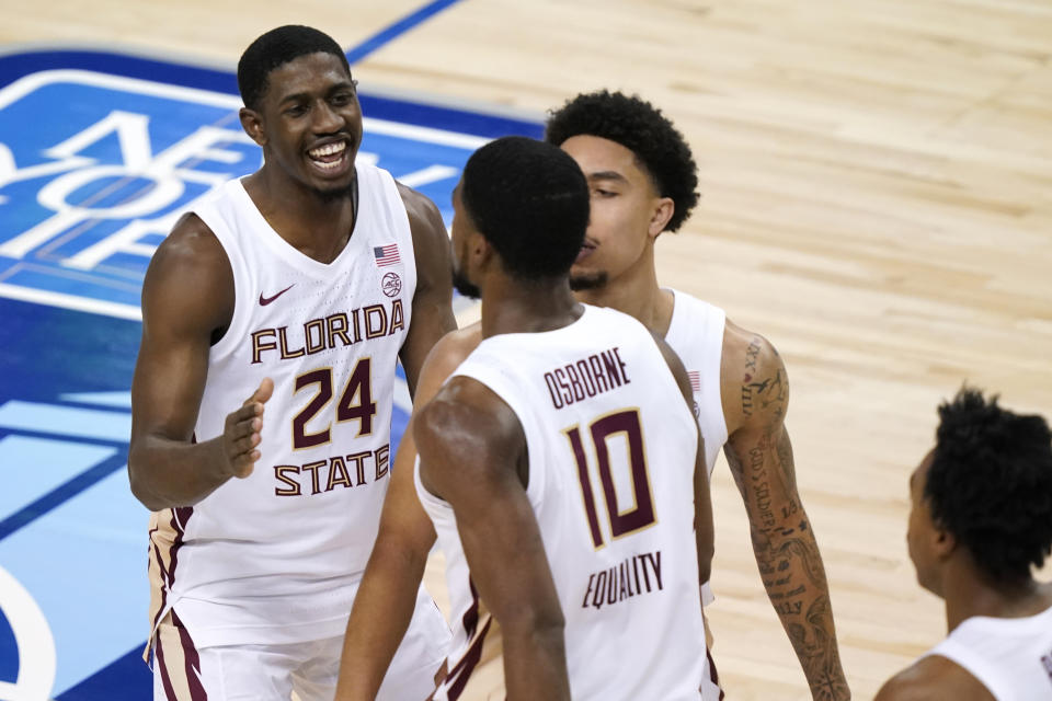 Florida State guard Sardaar Calhoun (24) and teammate guard Nathanael Jack (11) congradulate forward Malik Osborne (10) during the ACC tournament. (AP Photo/Gerry Broome)