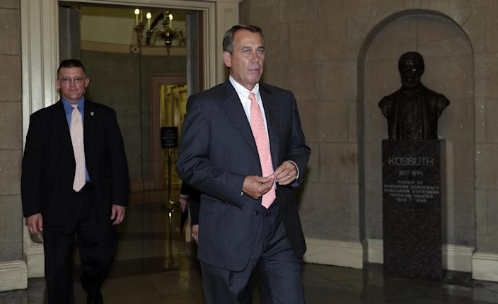 House Speaker John Boehner of Ohio walks on Capitol Hill in Washington, Wednesday, June 12, 2013, after meeting with families and friends of victims from the Sandy Hook Elementary School shooting Newtown, Conn. (AP Photo/Susan Walsh)