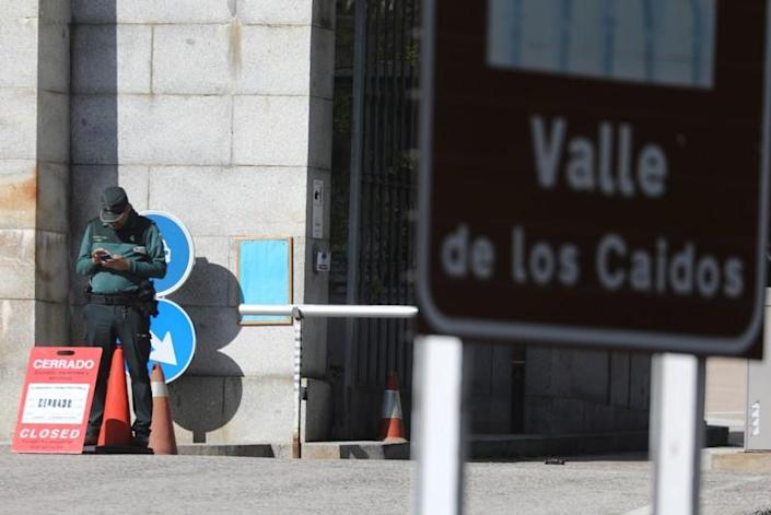 A Spanish Civil Guard officer stands in the closed entrance of the Valle de los Caidos (The Valley of the Fallen), in San Lorenzo de El Escorial