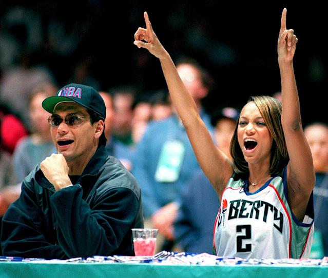 <p>Tyra Banks and actor Jimmy Smits judge the Celebrity Slam Dunk contest during the 1998 All-Star Weekend. </p>