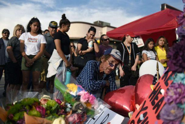 PHOTO: Antonio Basco looks at the cross bearing the name of his partner Margie Reckard, who died during the mass shooting at a Walmart store in El Paso, Texas, Aug. 7, 2019. (Callaghan O'Hare/Reuters)