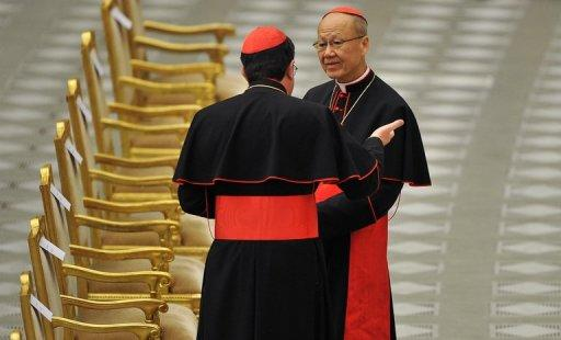 Cardinal John Tong Hon (R), pictured in February 2012