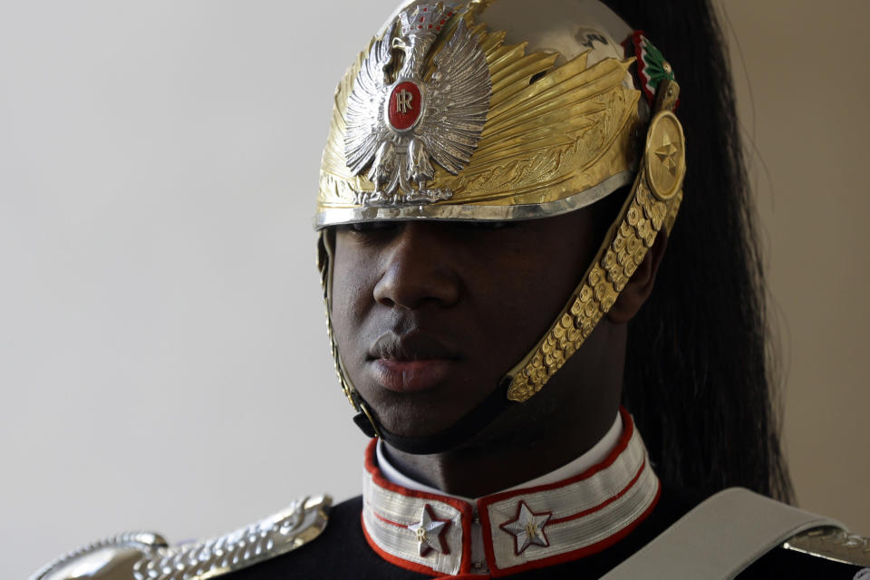 A Cuirassier presidential guard stands at attention prior to the start of the farewell ceremony for Chinese President Xi Jinping at the Quirinale Presidential Palace, in Rome, Saturday, March 23, 2019. (AP Photo/Gregorio Borgia)