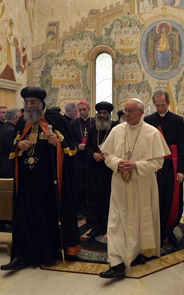 Pope Francis, right, and Coptic Orthodox Church of Egypt Pope Tawadros II, left, arrive in the Redemptoris Mater chapel to pray following their private audience, at the Vatican, Friday, May 10, 2013. The head of the Coptic Orthodox Church of Egypt, Pope Tawadros II, called on Pope Francis on Friday in the first such meeting in 40 years. The occasion was to mark the anniversary of the signing of a declaration for improving ties between the two churches between Pope Paul VI and Tawadros' predecessor, Pope Shenouda III. (AP Photo/Andreas Solaro, pool)