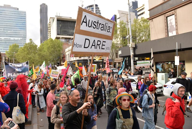 MELBOURNE, AUSTRALIA - OCTOBER 07 : Thousands of people gather as they stage a protest to draw attention to climate change and global warming, related the demonstrations of environmental and climate change activists from Extinction Rebellion group, on October 07, 2019 in Melbourne, Australia. (Photo by Recep Sakar/Anadolu Agency via Getty Images)