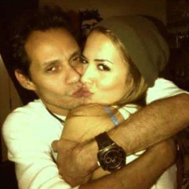 Celebrity couples: J-Lo's ex, Marc Anthony reacted to her Twitpic with this overly slushy snap showing off his girlfriend Shannon De Lima. Please guys, there's no need to fake kiss.