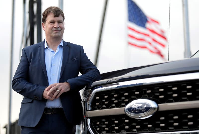 FILE PHOTO: Ford Motor Co. CEO Jim Farley poses next to a new 2021 Ford F-150 pickup truck at the Rouge Complex in Dearborn,