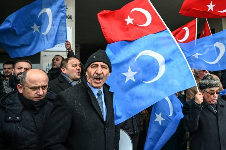 Demonstrators, seen here with Turkish flags and the flags of East Turkistan region used by Uyghur activists, have protested outside the Chinese embassy