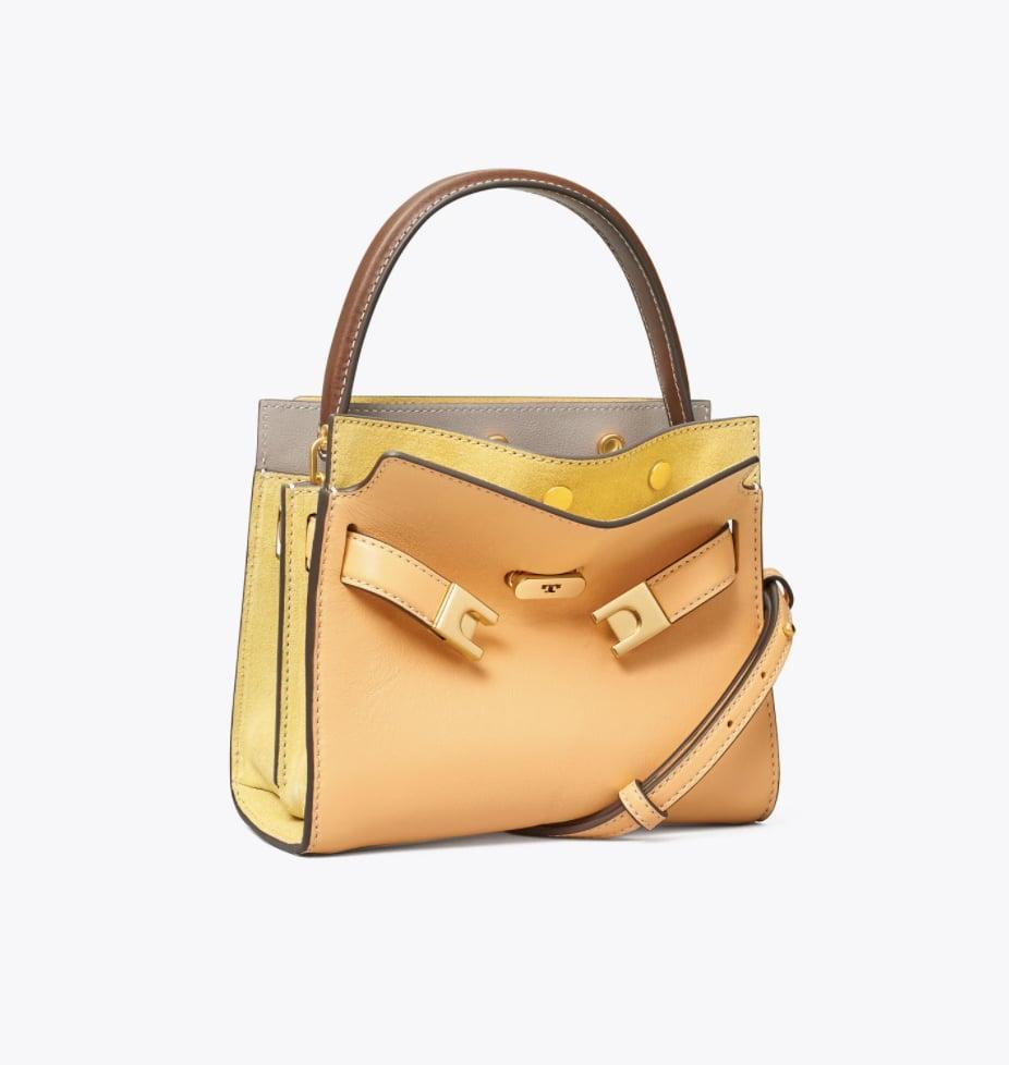 <p>For a dose of sunshine, reach for this <span>Tory Burch Lee Radziwill Petite Double Bag</span> ($598).</p>