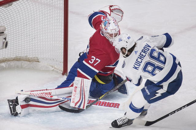Montreal Canadiens goaltender Antti Niemi (37) makes a save against Tampa Bay Lightning right wing Nikita Kucherov (86) during second-period NHL hockey game action in Montreal, Saturday, Feb. 24, 2018. (Graham Hughes/The Canadian Press via AP)