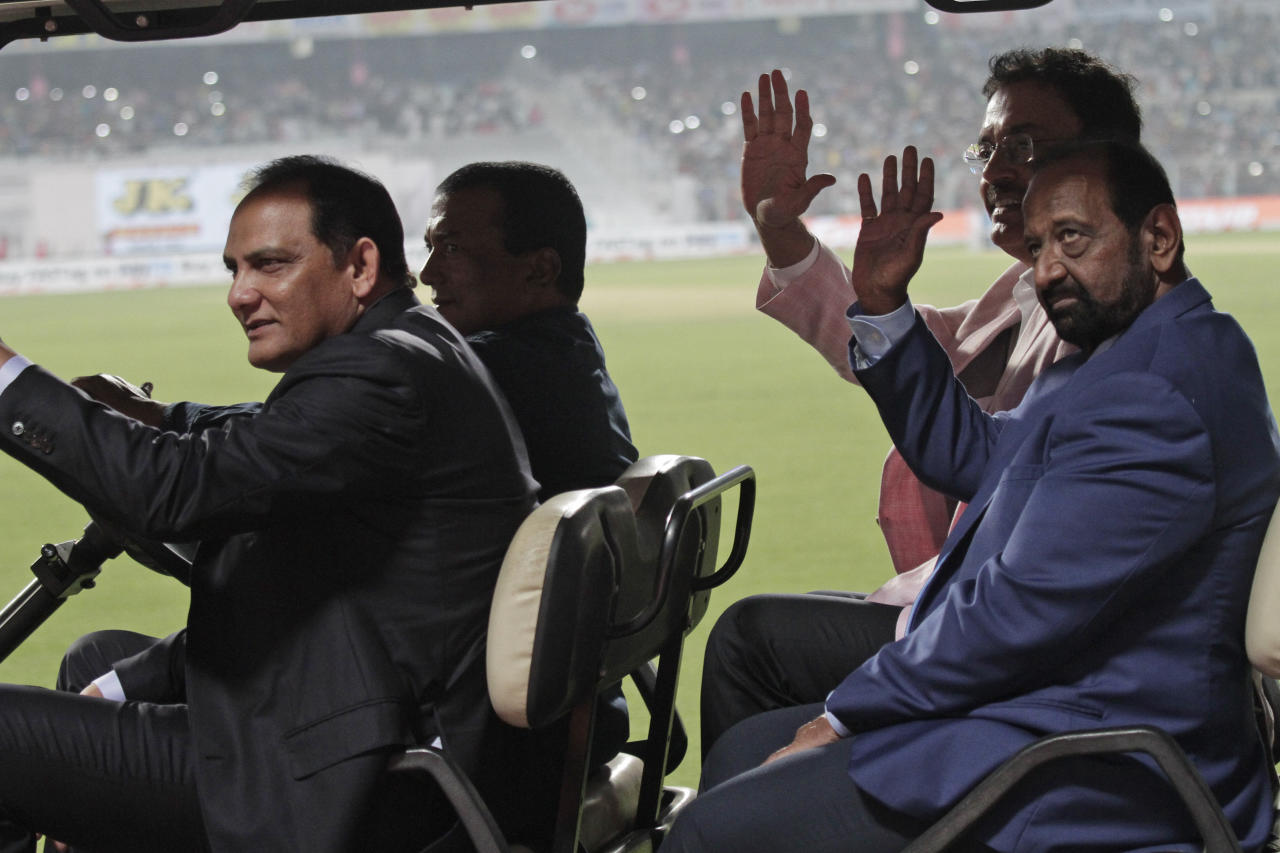 Mohammad Azharuddin, front, Gundappa Viswanath, back and Dilip Vengsarkar, rear, acknowledge the crowd during a grand parade of India's former cricket captains during the first day of the second test match between India and Bangladesh, in Kolkata, India, Friday, Nov. 22, 2019. (AP Photo/Bikas Das)