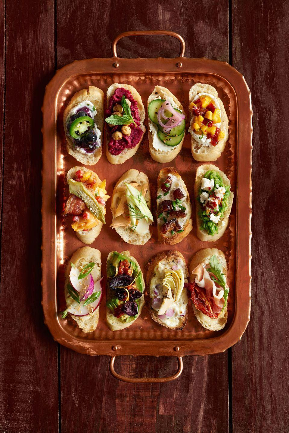 """<p>This platter of easy two-bite crostini will give guests something to graze on as you fiddle with the main course. Choose your favorite of our 12 recipes, or make them all! </p><p><strong><a href=""""https://www.countryliving.com/food-drinks/g2706/crostini-thanksgiving-recipes/"""" rel=""""nofollow noopener"""" target=""""_blank"""" data-ylk=""""slk:Get the recipe"""" class=""""link rapid-noclick-resp"""">Get the recipe</a>.</strong></p>"""