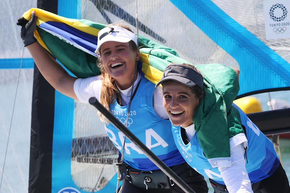 FUJISAWA, JAPAN - AUGUST 03: Martine Grael (r) and Kahena Kunze of Team Brazil celebrate winning gold in the Women's Skiff 49er class on day eleven of the Tokyo 2020 Olympic Games at Enoshima Yacht Harbour on August 03, 2021 in Fujisawa, Japan. (Photo by Phil Walter/Getty Images)
