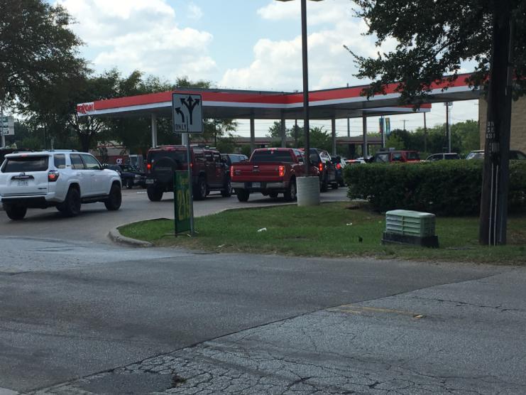 A line of cars forms outside a Dallas Exxon as people wait to fill up. (Cindy Bagwell)