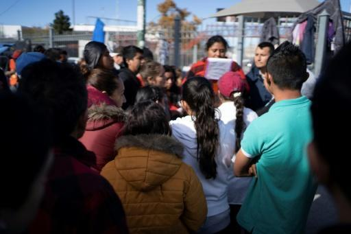"""A woman from Guererro State who is in charge of the """"ficha,"""" or the list system used for asylum seekers waiting to cross into the US, gathers money to pay for newly issued cards"""