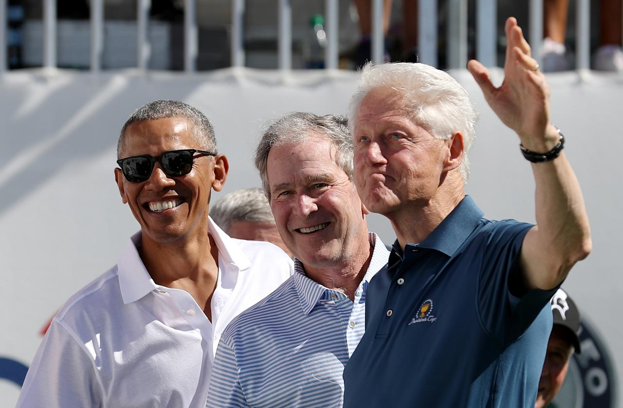 <p>Former U.S. Presidents Barack Obama, George W. Bush and Bill Clinton attend the trophy presentation prior to Thursday foursome matches of the Presidents Cup at Liberty National Golf Club on Sept. 28, 2017 in Jersey City, N.J. (Photo: Rob Carr/Getty Images) </p>