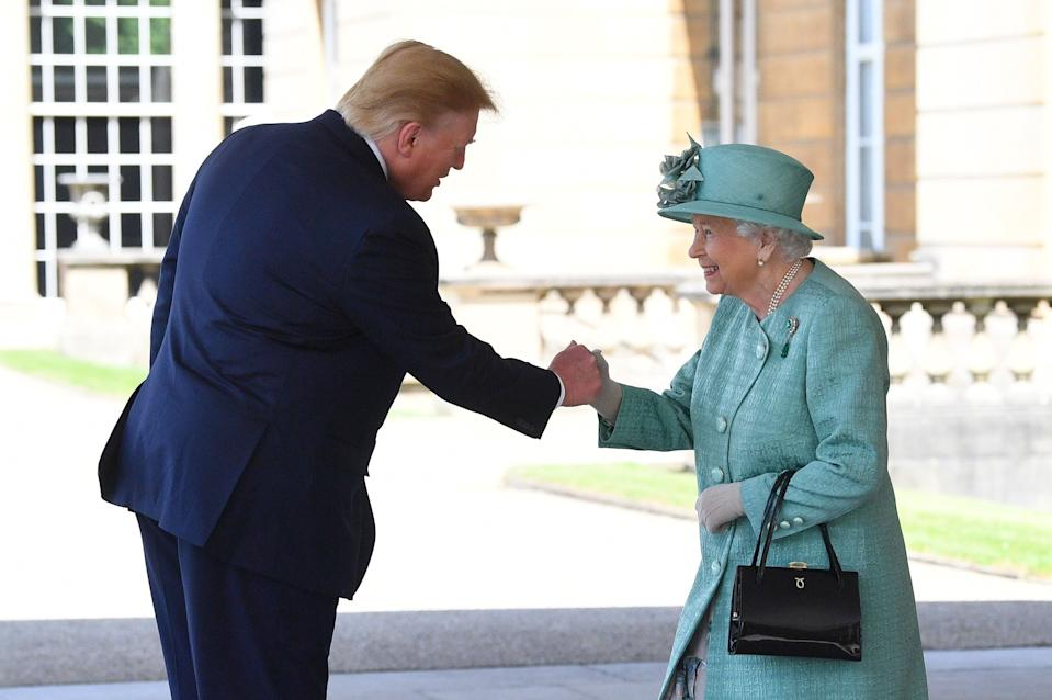 Queen Elizabeth II greets US President Donald Trump as he arrives for the Ceremonial Welcome at Buckingham Palace, London, on day one of his three day state visit to the UK.
