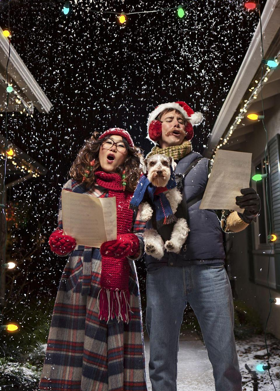 <p>Call around the neighborhood beforehand and map out which houses would like to hear you belt out some tunes on Christmas Day or another time during the festive season. Then make the rounds after dinner. Just remember to bring flashlights if your street isn't well-lit. </p>