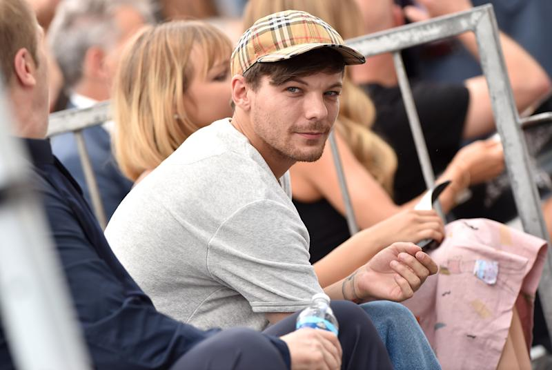 HOLLYWOOD, CA - AUGUST 22: Louis Tomlinson attends the ceremony honoring Simon Cowell with star on the Hollywood Walk of Fame on August 22, 2018 in Hollywood, California. (Photo by Axelle/Bauer-Griffin/FilmMagic)