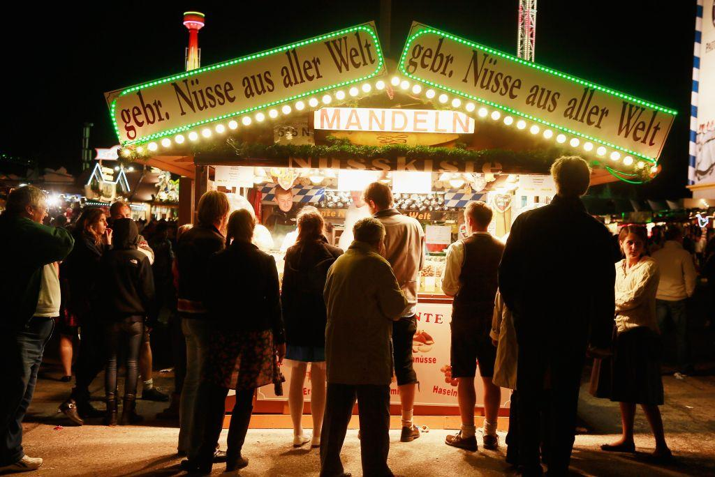 A booth selling fried nuts attracts people at the Oktoberfest.