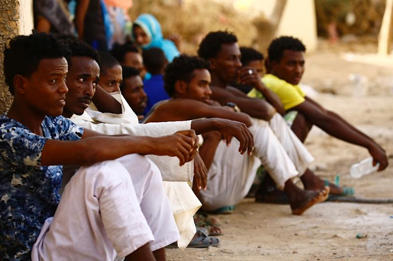 Eritrean migrants sit at the Wadi Sherifay camp on May 2, 2017, after being caught by Sudanese border security illegally crossing the Eritrea-Sudan border in the eastern Kassala state (AFP Photo/ASHRAF SHAZLY)