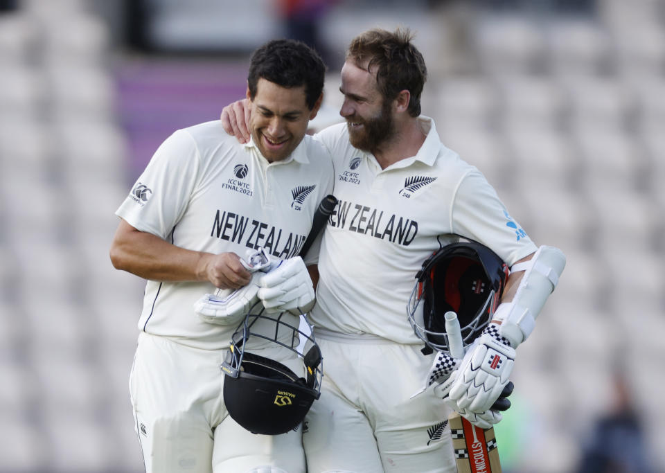 Cricket - ICC World Test Championship Final - India v New Zealand - Rose Bowl, Southampton, Britain - June 23, 2021 New Zealand's Kane Williamson and Ross Taylor celebrate after winning the ICC World Test Championship Final Action Images via Reuters/John Sibley