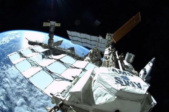 The Alpha Magnetic Spectrometer experiment hangs on the side of the International Space Station, July 12, 2011.