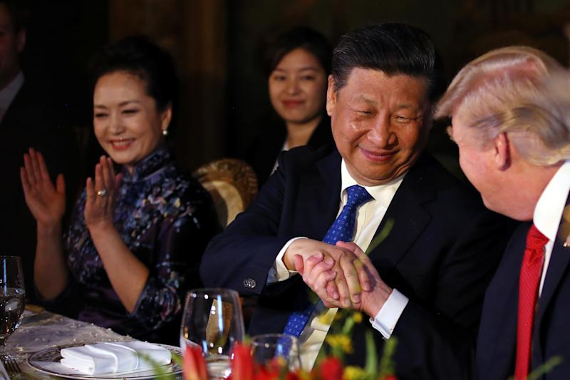 Chinese President Xi Jinping shakes trump's hand during a dinner at the start of a summit at the president's Mar-a-Lago estate in April. (Carlos Barria/Reuters)