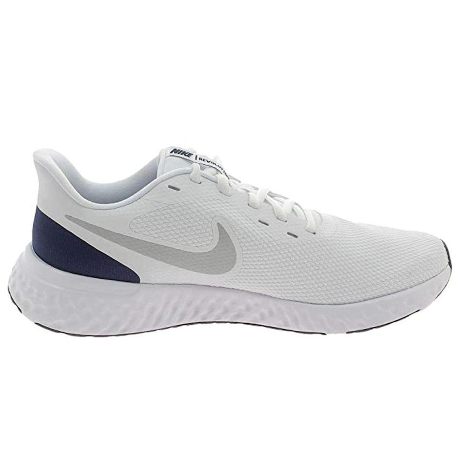 """<p><strong>Nike</strong></p><p>amazon.com</p><p><strong>$88.99</strong></p><p><a href=""""https://www.amazon.com/dp/B07Y86C1JB?tag=syn-yahoo-20&ascsubtag=%5Bartid%7C2139.g.36608417%5Bsrc%7Cyahoo-us"""" rel=""""nofollow noopener"""" target=""""_blank"""" data-ylk=""""slk:BUY IT HERE"""" class=""""link rapid-noclick-resp"""">BUY IT HERE</a></p><p>12,500+ 5-star Amazon reviews, a lightweight, minimalist design, and plush lining—there's a lot to love about Nike's Revolution 5, especially if you're a marathon regular. You'll particularly appreciate the reinforced heel and overlays, which offer support and durability mile after mile. Plus, thanks to the sturdy cushioned midsole, you can count on each step being smooth and stable. </p>"""
