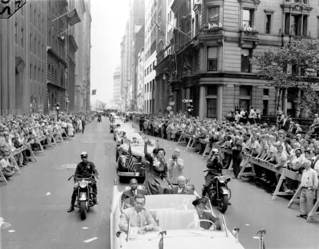 FILE - In this July 11, 1957, file photo, Althea Gibson, who won the Wimbledon women's singles and doubles, smiles and waves to the crowd from the backseat of the open car during a ticker-tape parade up Broadway in New York. Gibson basked in a ticker tape parade in New York a decade before Arthur Ashe won the 1968 U.S. Open. (AP Photo/File)