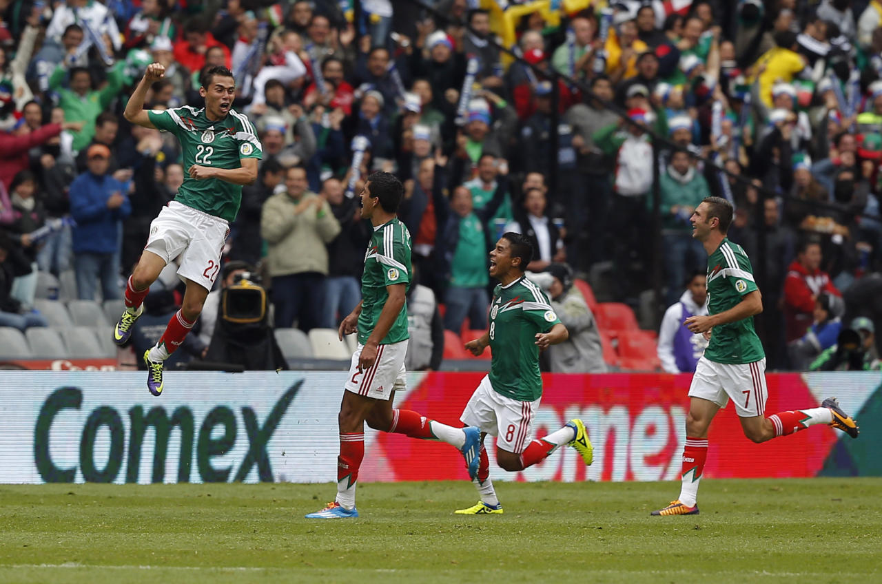CORRECTS NAME OF PLAYER - Mexico's Paul Aguilar, left, celebrates his goal during a 2014 World Cup playoff first round match against New Zealand in Mexico City, Wednesday, Nov. 13, 2013. (AP Photo/Eduardo Verdugo)