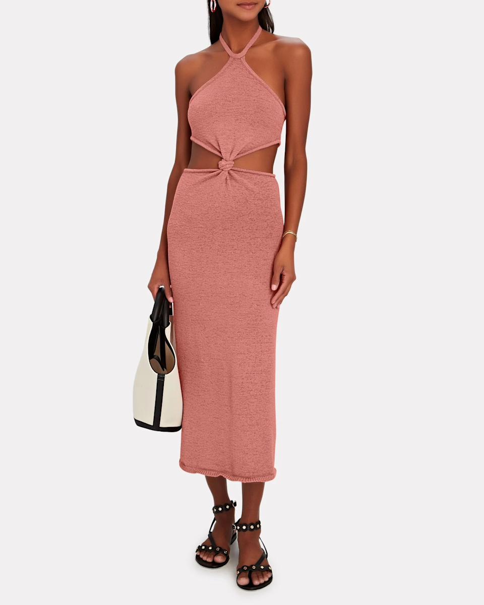 """<h2>Cut-Outs</h2><br>""""This is the summer of the cut-out! Baring some skin is suddenly appropriate for day, night, and everything in between.""""<br><br>- Divya Mathur, Chief Merchant at INTERMIX <br><br><strong>Cult Gaia</strong> Cameron Knit Cut-Out Midi Dress, $, available at <a href=""""https://go.skimresources.com/?id=30283X879131&url=https%3A%2F%2Fwww.intermixonline.com%2Fcult-gaia%2Fcameron-knit-cut-out-midi-dress%2FKD1761YN-PNK.html"""" rel=""""nofollow noopener"""" target=""""_blank"""" data-ylk=""""slk:Intermix"""" class=""""link rapid-noclick-resp"""">Intermix</a>"""